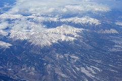 Aerial view of mountains. With snow on them royalty free stock image