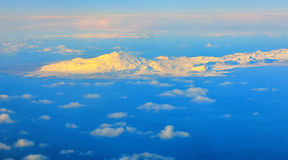 Aerial view of mountains and clouds on top Royalty Free Stock Photo