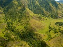 Aerial view of the mountains with green grass and trees with lot stock photo