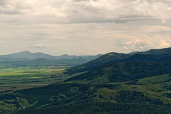 Aerial view mountains hills flat land Royalty Free Stock Photography