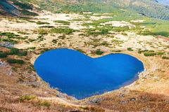 Aerial view of heart-shape mountains lake Royalty Free Stock Photos