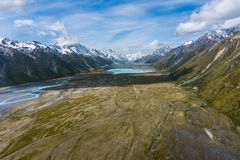 Aerial view of mountains in New Zealand. Aerial view of mountain ranges in Mount Cook National Park, New Zealand. Shot from helicopter Stock Photos