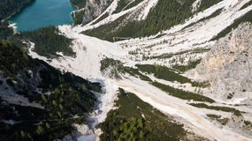 Aerial view of the mudflow with snow high in the Alpine mountains Stock Image