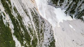 Aerial view of the mudflow with snow high in the Alpine mountains, Top view Stock Photography