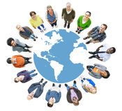 Aerial View of Multiethnic People Forming Circle and Globe Stock Photos