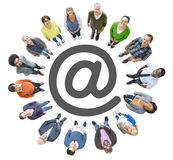 Aerial View of Multiethnic People Forming Circle and 'At' Symbol Stock Photos