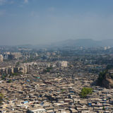 Aerial view of Mumbai slums. The slums of Mumbai, seen from the air, fill every gap between larger residential buildings and offices stock image