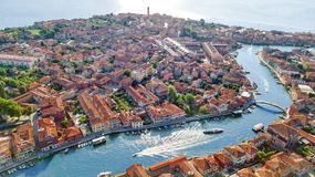 Aerial view of Murano island in Venetian lagoon sea from above, Italy stock photo