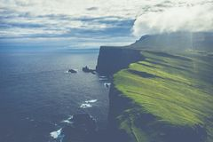 Aerial view of Mykines island in Faroe Islands, North Atlantic Ocean. Photo made by drone from above. Nordic natural landscape