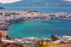 Mykonos City, Chora on island Mykonos, Greece. Aerial view of Mykonos City, Chora with Old Port, white houses, windmilles and churches on the island Mykonos, The Royalty Free Stock Photography