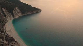 Aerial view of Myrtos beach at sunset, the most beautiful beach of Kefalonia stock footage