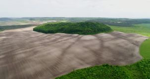 Beautiful space landscape. Aerial view of mystical green trees island on a field. Aerial view of mystical green trees island on a field. Beautiful space stock video