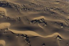 Aerial view of Namib desert sand dunes. In the early morning light over the Namib-Naukluft Park in Namibia stock images