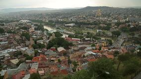 Aerial view of narrow streets and closely located houses in cozy Tbilisi city. Stock footage stock footage