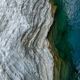 Aerial view of natural wavy rocky formation along the river. Abstract rough natural design. /background royalty free stock photo