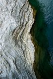 Aerial view of natural wavy rocky formation along the river. Abstract rough natural design. /background stock images