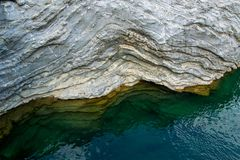 Aerial view of natural wavy rocky formation along the river. Abstract rough natural design. /background stock photo
