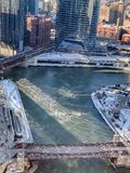 Aerial view of nature`s reaction to temps plunging as steam rises from Chicago River. On January winter morning stock images