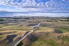 Aerial view of Nebraska Sandhills. Aerial view of sandy road in Nebraska Sandhills near Seneca, spring scenery with morning light Stock Image