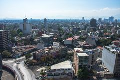 Aerial view of a neighborhood called Colonia Juarez in Mexico City, Mexico, on a sunny morning with some haze. royalty free stock images