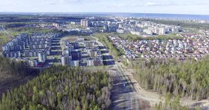 Aerial view of low-rise houses and cheap high-rise housing in outskirts. Aerial view of the neighborhood of low-rise houses and cheap high-rise housing in new stock footage