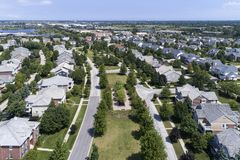 Neighborhood Aerial View With Parkway. Aerial view of a neighborhood in suburban Chicago with homes on either side of a parkway Royalty Free Stock Photos