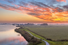 Aerial view of Netherlands Polder landscape. With winding cycling track along river under beautiful sunset Stock Photography