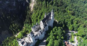 Aerial view of Neuschwanstein Castle at green summer landscape. Germany. 4K stock video footage