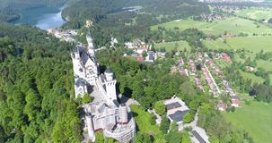 Aerial view of Neuschwanstein Castle at green summer landscape. Germany. 4K stock footage