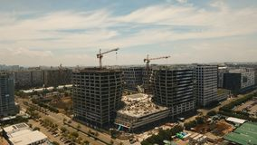 Building under construction with cranes in the city. Philippines, Manila, Makati. Aerial view new building is being constructed with use of tower crane in Mall Royalty Free Stock Photography