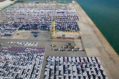 Aerial view of new car storage parking lot. Stock Images