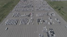 Aerial view of new car storage parking lot. Car park view from above. stock footage