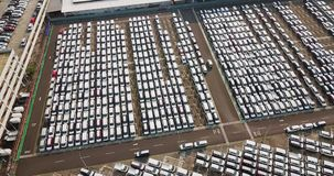 Aerial view of new cars lined up outside stock video footage
