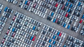 Aerial view new cars lined up in the port for import and export,. Top view of new cars lined up outside an automobile factory for import & Export Royalty Free Stock Photography