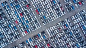 Aerial view new cars lined up in the port for import and export,. Top view of new cars lined up outside an automobile factory for import & Export Royalty Free Stock Images