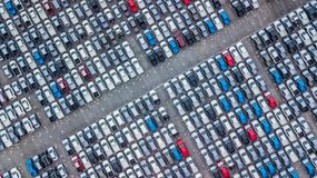Aerial view new cars lined up in the port for import and export,. Top view of new cars lined up outside an automobile factory for import & Export Royalty Free Stock Photo
