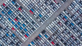 Aerial view new cars lined up in the port for import and export,. Top view of new cars lined up outside an automobile factory for import & Export Royalty Free Stock Photos