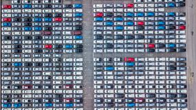Aerial view new cars lined up in the port for import and export,. Top view of new cars lined up outside an automobile factory for import & Export Stock Images