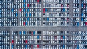 Aerial view new cars lined up in the port for import and export,. Top view of new cars lined up outside an automobile factory for import & Export Stock Photos