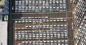 Aerial view of new cars parked outside stock footage