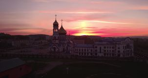 Aerial view of new church at dawn in small town. beautiful sky in sunrise. 4K. Aerial view of new church at dawn in small town. beautiful sky in sunrise stock video footage