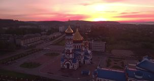 Aerial view of new church at dawn in small town. beautiful sky in sunrise. 4K. Aerial view of new church at dawn in small town. beautiful sky in sunrise stock video