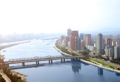 Aerial view of Pyongyang, capital city of the DPRK, North Korea. Aerial view of new residential complex and Daedong River Taedong River, Pyongyang - capital city Royalty Free Stock Photos