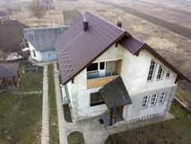 Aerial view of new residential house cottage with shingle roof.  royalty free stock photo