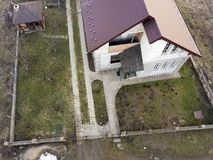 Aerial view of new residential house cottage with shingle roof.  stock image
