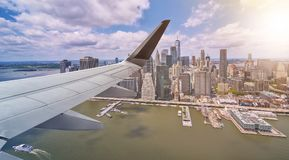 Aerial New York City with airplane wing Stock Photos