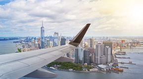 Aerial New York City with airplane wing Stock Images