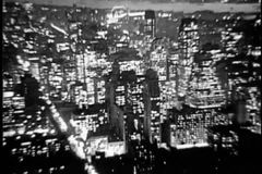 Aerial view of New York City at night, 1930s stock video