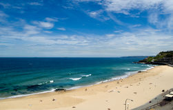 Aerial view of Newcastle Beach; Newcastle, New Sou. White sand public surf beach in downtown Newcastle, viewed from above, with blue summer skies and distant royalty free stock photos