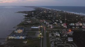 Aerial view of the night city. 4k. Flying with drone at night above Rodanthe, NC, USA. Between ocean and sound stock video